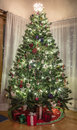 Christmas tree in home a lighting up the holidays a Stock Photography