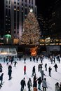 Christmas tree and ice skating rink at Rockefeller Center at night, in Midtown Manhattan, New York City Royalty Free Stock Photo
