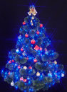 Christmas tree with light and blue star. Stock Images