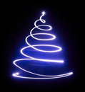 Christmas tree with light and blue star. Royalty Free Stock Photo