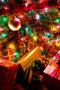 Christmas Tree Lights and Ornaments with Wrapped P Stock Images