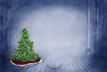 Christmas tree a lone pine with a wooden star and bright red blanket under the Royalty Free Stock Photo