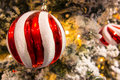 Christmas tree macro shot of a red and white ball on a Royalty Free Stock Photo