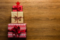 Christmas tree made of beautifully wrapped presents on wooden background view from above Stock Images