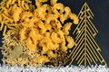 Christmas tree made with italian spaghetti with salt on a slate background. New Year background made with pasta Royalty Free Stock Photo