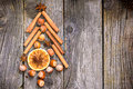 Christmas tree made of nuts, spices and dried oranges. Royalty Free Stock Photo
