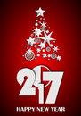 Christmas Tree made of stars and snowflakes on red background. New Year 2017 concept Royalty Free Stock Photo