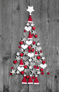 Christmas tree made up of decoration on grey wooden background Royalty Free Stock Photo