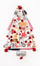 Christmas tree of old and antique miniatures in red, silver and
