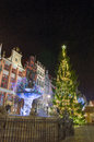 Christmas tree in the old town in gdansk by night and neptune s fountain of poland Stock Images