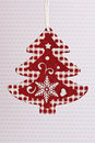 Christmas tree ornament red and white paper Stock Image