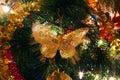 Christmas tree ornaments, bright shiny butterfly Royalty Free Stock Photo