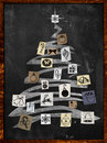 Christmas tree paper ornament on blackboard Stock Photo