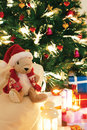 Christmas tree with presents underneath with christmas lighted toy Stock Images