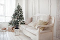 Christmas tree with presents underneath in living room vintage Royalty Free Stock Image