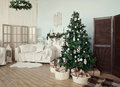 Christmas tree with presents underneath in living room vintage сhristmas Stock Images