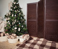 Christmas tree with presents underneath in living room vintage сhristmas Stock Photography