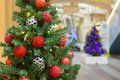 Christmas tree with red decoration in shopping mall Stock Photography