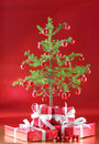 Christmas tree, red presents Stock Photography