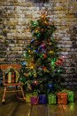 Christmas Tree and Red Rocking Chair