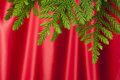 Christmas Tree Red Satin Background Royalty Free Stock Photo
