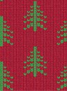 Christmas tree seamless knitted pattern. Green pixel images with red background.