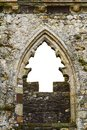 Christmas tree shape in a castle's window Royalty Free Stock Photo