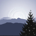 Christmas tree silhouette on a mountain background d vector Stock Images