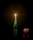 Christmas tree a spiral glass and red ornament on black Royalty Free Stock Photos