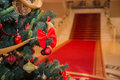 Christmas tree with staircase and red carpet on the background Stock Image
