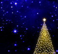 Christmas tree on stars sky background. Royalty Free Stock Photo