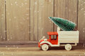 Christmas tree on toy truck car. Christmas holiday concept Royalty Free Stock Photo