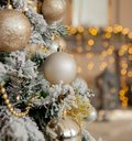 Christmas tree with toys and decorative snow for a happy new year on background of bokee Royalty Free Stock Photo