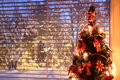 Christmas tree by the window Royalty Free Stock Photo