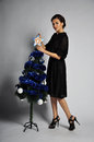 Christmas tree young woman decorate the Stock Images
