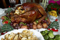 Christmas turkey dinner of with stuffing and vegetables on a dining table Stock Image