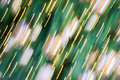Christmas very blurred holiday abstract background. Blurred christmas balls ornaments on tree and golden lights Royalty Free Stock Photo