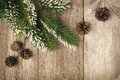 Christmas vintage background with fir branches and cones horizontal close up Stock Photos