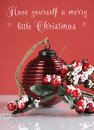 Christmas vintage bauble and berries and mistletoe holly decoration with sample text festive red white theme Stock Photos