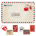 Christmas vintage postcard with postage stamps for design scrapbook in Royalty Free Stock Image