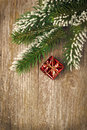 Christmas vintage wooden background spruce branches and gift with gifts vertical Royalty Free Stock Image
