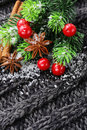 Christmas warm knitted background with fir tree and spices anise cinnamon Royalty Free Stock Image