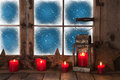 Christmas window with red burning candles and a lantern for a ba decoration background Royalty Free Stock Image