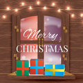 Christmas window view with a snowy landscape Royalty Free Stock Photo