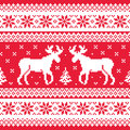Christmas and winter knitted pattern with reindeer red blue xmas seamless background scandynavian sweater style Royalty Free Stock Images