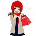 Christmas winter shopping girl beautiful brunette on day holding credit card and bags full of gifts and presents Royalty Free Stock Photos