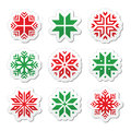 Christmas winter snowflakes icons set red and green labels isolated on white Royalty Free Stock Photo