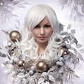Christmas or winter woman snow queen portrait of fashion girl with silver and gold balls over snowflakes background Royalty Free Stock Photography