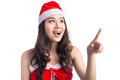Christmas Woman. Beauty Asian Model Girl in Santa Hat isolated o Royalty Free Stock Photo