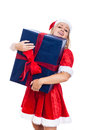 Christmas woman carrying huge present excited isolated on white background Stock Photography